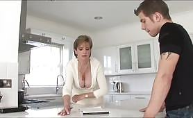 Busty mature slut gets seduced by her horny stepson and the slut can't resist the temptation to indulge her hot juicy pussy and gets fucked in the kitchen.