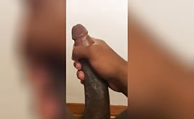 A big handed black guy grabs his huge dick and masturbates in this amateur POV porn video. His dick is so big that it looks like he's just masturbating only his head. He goes faster and faster and pours a huge amount of cum.