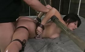 Hardcore BDSM fuck on a bed with a brunette getting pounded on her ass with a whip and being teased by a vibrator letting her pussy with juices