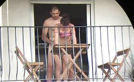 The mature couple is having sexual intercourses on the balcony where everybody can see them while they are fucking hard - amateur voyeur italian sex