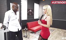 The lady in red dress gives a wonderful blowjob to the black guy, and then he lies down while she rides his big cock anally. He pounds her asshole hard.
